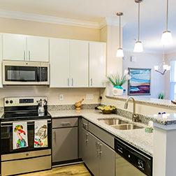 Model Interior Kitchen with Stainless Steele Kitchen Appliances